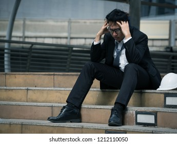 Older employees who sit in the corridor atmosphere. fall in stress after being pressured boss's sales slump at risk of being laid off. Economic crisis causes job losses and unemployment.