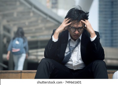 Older Employees who sit in the corridor atmosphere. The fall in stress after being pressured boss's sales slump at risk of being laid off.Economic crisis causes job losses and Unemployment.