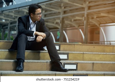 Older Employees who sit in the Corridor Atmosphere. The fall in Stress after being pressured boss's Sales Slump at Risk of being laid off. Economic crisis causes job Losses and Unemployment.