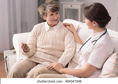 Older friendly woman and her nice young carer