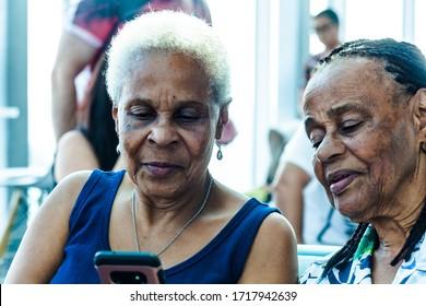 OLDER GENERATION, FEMALE, USING TECHNOLOGY-21st DECEMBER 2019:-Older generation black women utilising modern technology