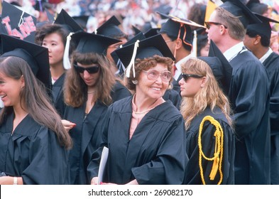 An older graduate smiles at her ceremony from UCLA, Los Angeles, CA