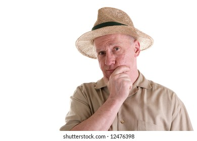 An older guy in a brown shirt wearing a straw hat with his hand on his chin