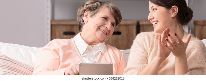Older happy woman and new wireless technology