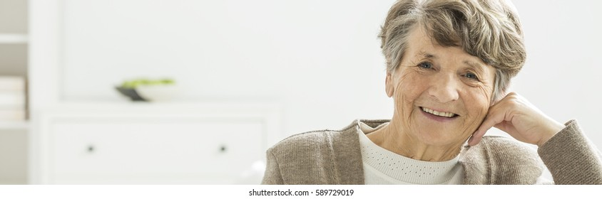 Older happy woman spending afternoon in nursing home