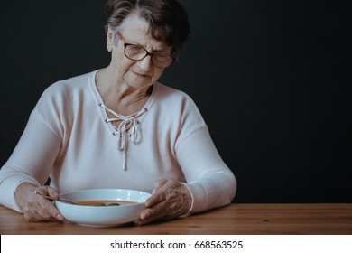 Older lady during dinner suffering from lack of appetite