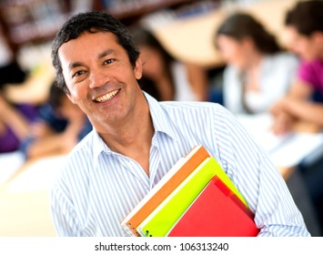 Older male student at the university smiling
