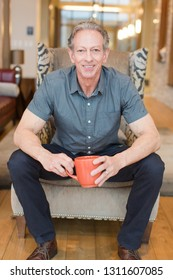 Older man with coffee mug