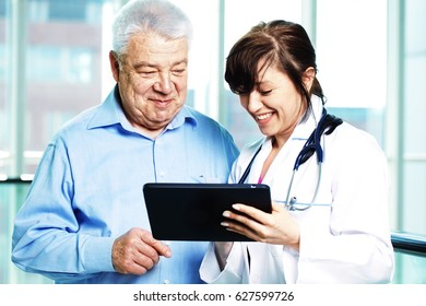 older man and female doctor examine results on tablet pc
