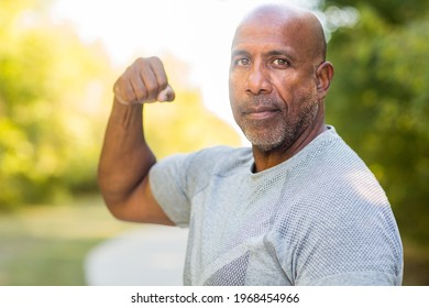 Older man flexing his bicep muscle