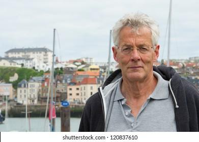 older man in harbor in French Dieppe