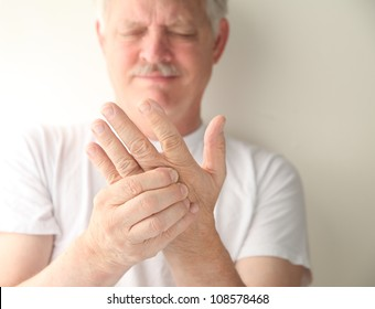 an older man has numbness and tingling in his hand