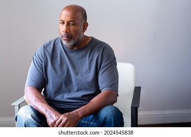 Older man looking sad and depressed.