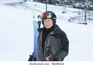 Older Man on Mountain Skiing at a Colorado Resort. Wearing all Safety Equipment.