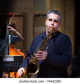 Older man playing sax