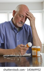Older man with prescription medications.