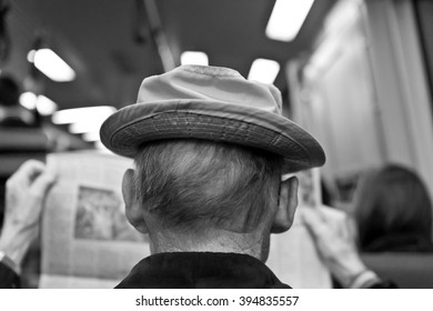 Older Man Reading Newspaper on Commuter Train Black and White