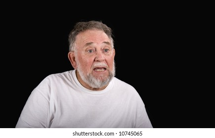 An older man in a white t-shirt showing confusion or perplexity