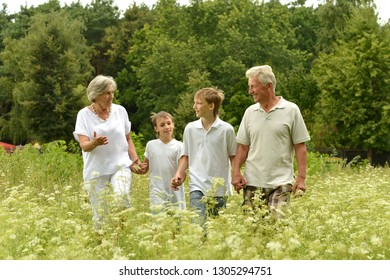 Older man and woman with their grandchildren