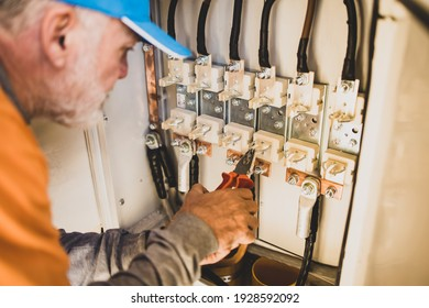 Older man,electrician on his workplace