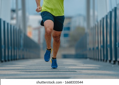Older mature man in good shape during a running exercise on a bridge
