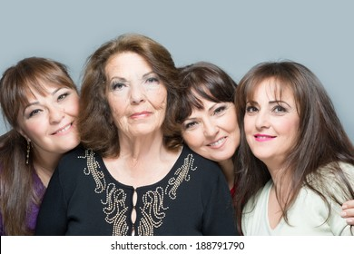 An older mother with three daughter all smiling and having fun
