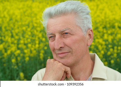 Older people are enjoying the fresh air surrounded by nature