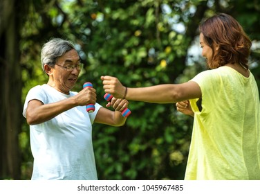 Older people are exercising healthy. Elderly man holding dumbbells. Soft focus concept.