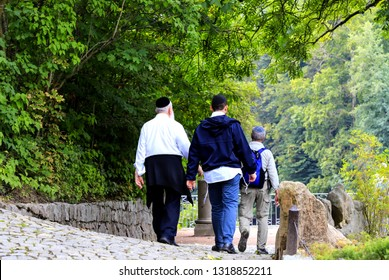 Older people, a Hasidic Jews family  walk in the Sofia park during the Jewish New Year. Uman, Ukraine