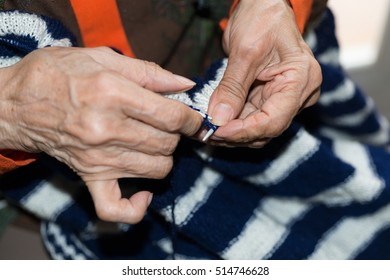 Older person doing a knitted sweater
