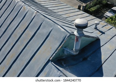 Older rusty gray metal roof picture.