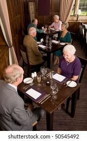 Older senior couples sitting in smart restaurant