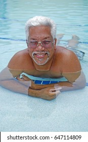 Older senior man relaxes in the pool