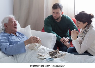 Older sick man in hospital opening old letters