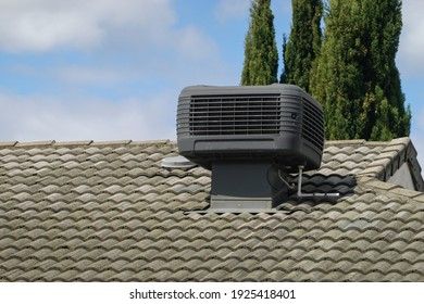 Older Style Evaporative Cooler on Roof of House