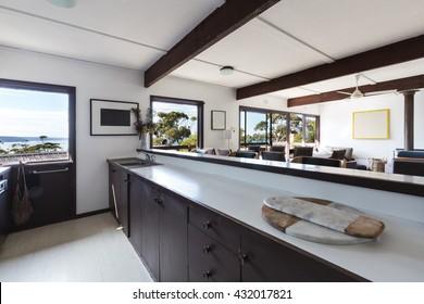 Older style kitchen living area in retro 70s Australian beach house
