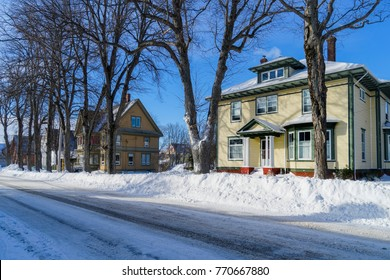Older traditional houses in wintertime in a North American neighborhood.