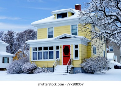 Older traditional North America home in winter.