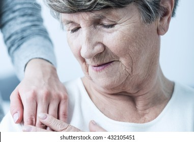 Older woman is comforted with compassion by gentle touch