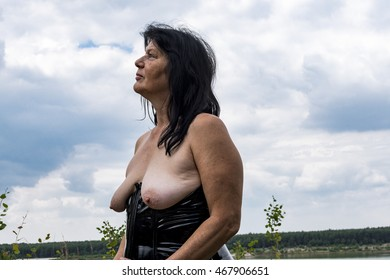 Older woman with corsage topless