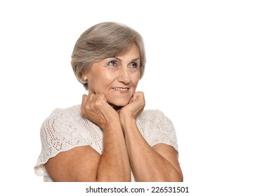 Older woman is happily surprised on white background
