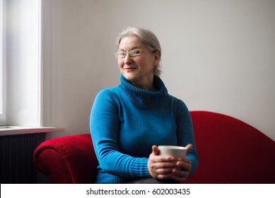 Older woman holding a cup of tea