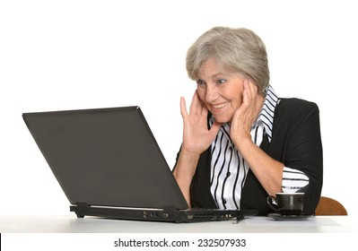 Older woman with a laptop on a white background