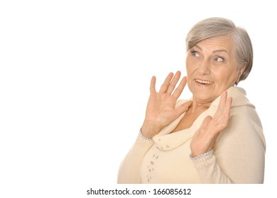 older woman showing your product on a light background