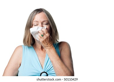 Older woman suffering with allergy's or a cold