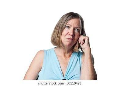 Older woman totally confused, looking bemused