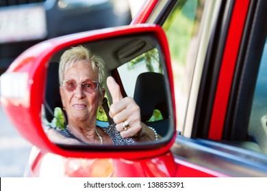 older woman wearing a seatbelt when in a car.