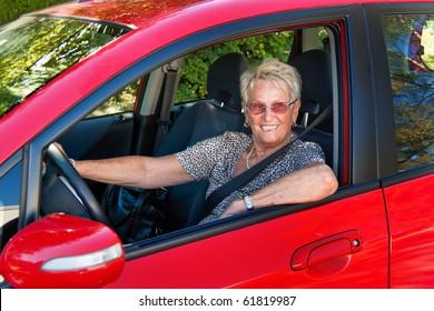 Older Woman when wearing a seat belt in a car.