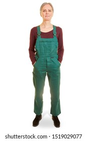 Older woman as a worker in green dungarees frontal from the front
