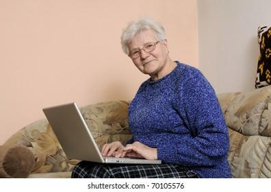 older woman working on laptop